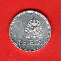 Испания монета 1 песет 1989 года.